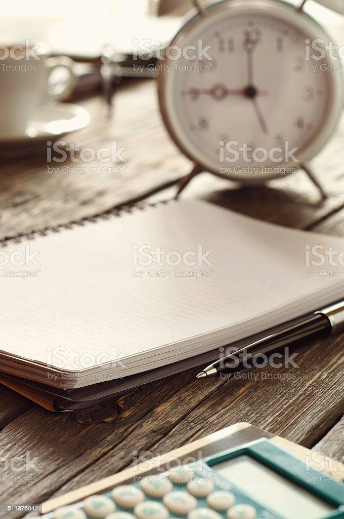 workplace with notebook, pen, calculator with credit card and cl stock photo