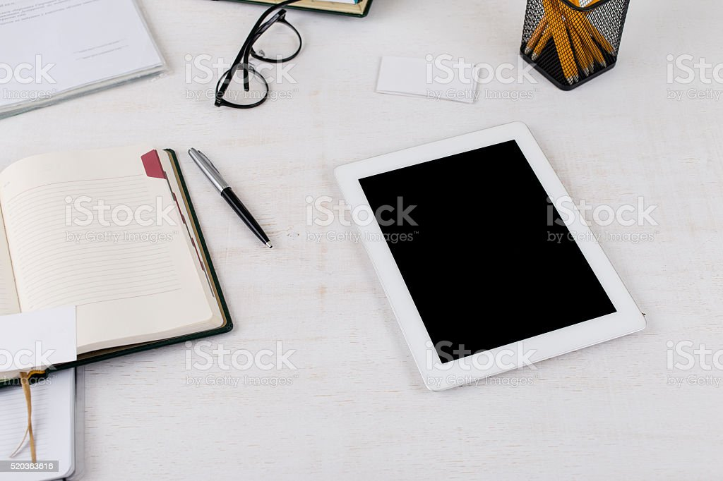 workplace with white tablet computer with blank screen stock photo