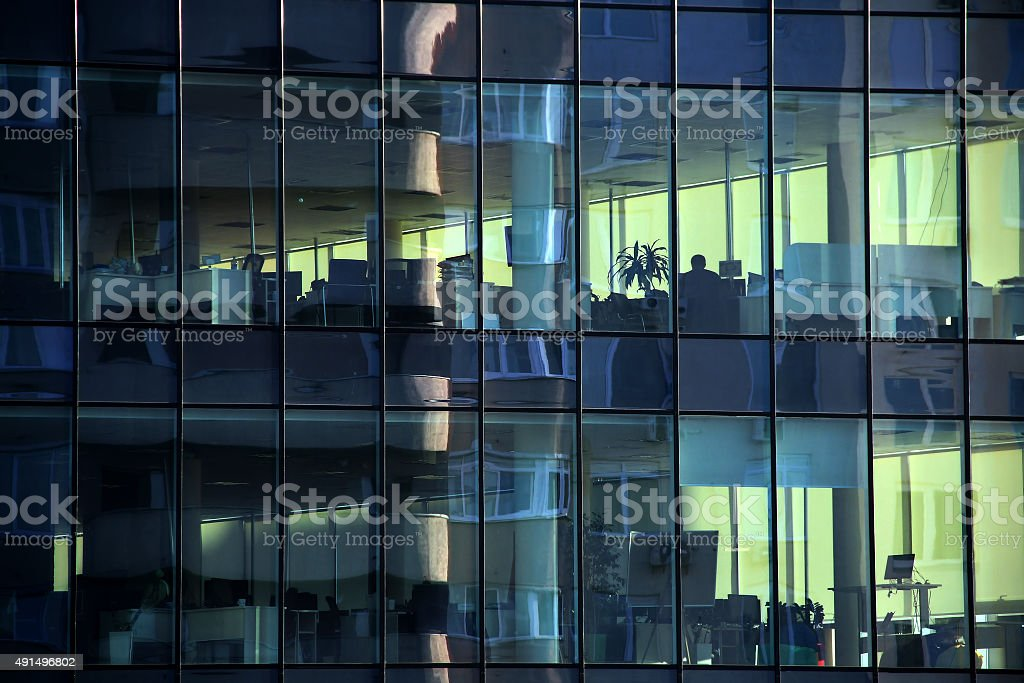 Workplaces behind clear windows in financial building stock photo