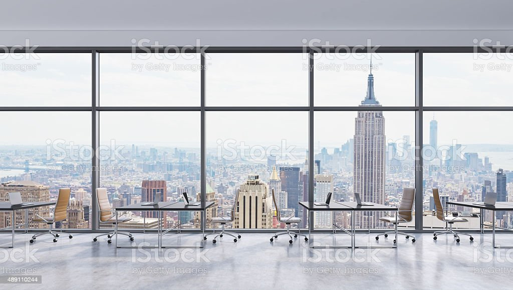 Workplaces in a modern panoramic office, New York city view stock photo
