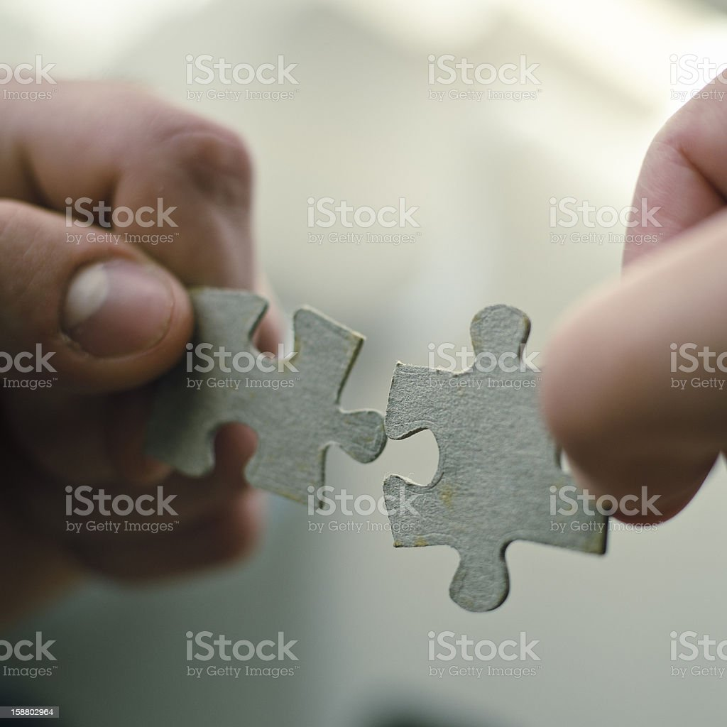 Works Connection : holding the puzzle stock photo