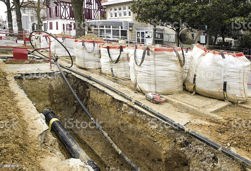 Works of burying of cables stock photo