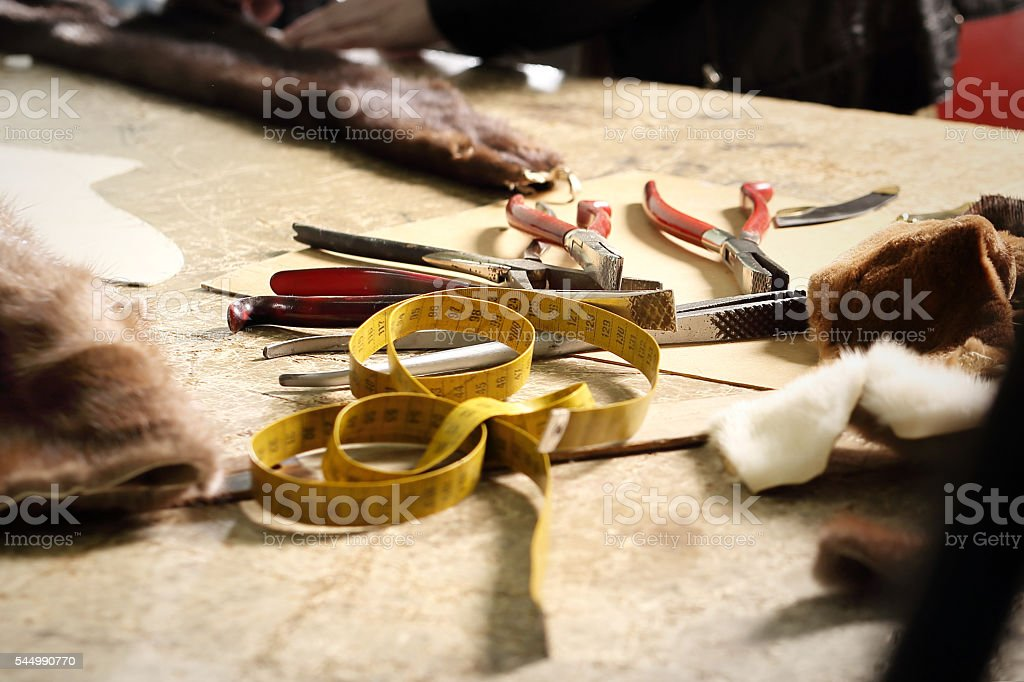 Workshop furrier, utensils, tools and pieces of natural fur stock photo