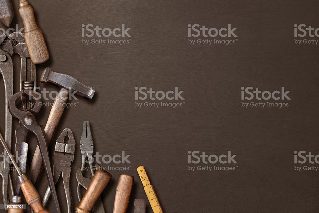 Workshop hand tools on a black background stock photo