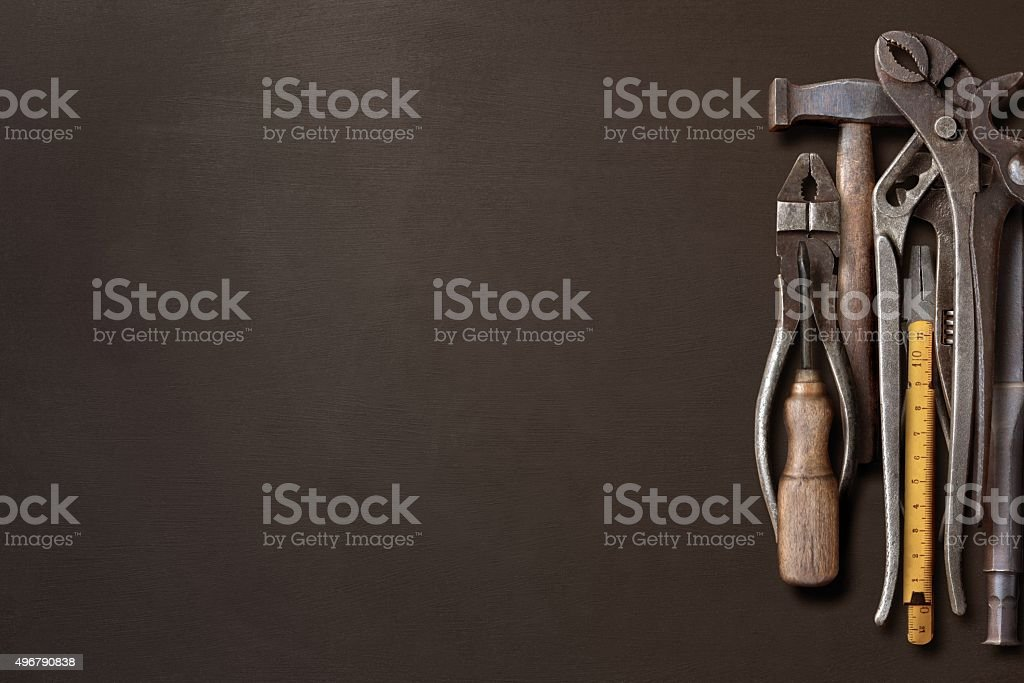 Workshop hand tools piled on a black background stock photo