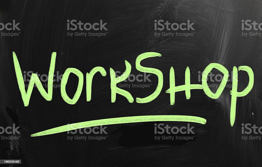 'Workshop' handwritten with white chalk on a blackboard royalty-free stock photo