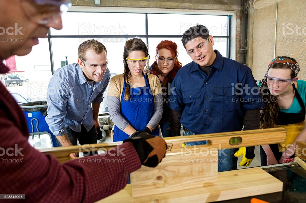 Workshop manager uses leveler tool in workshop stock photo