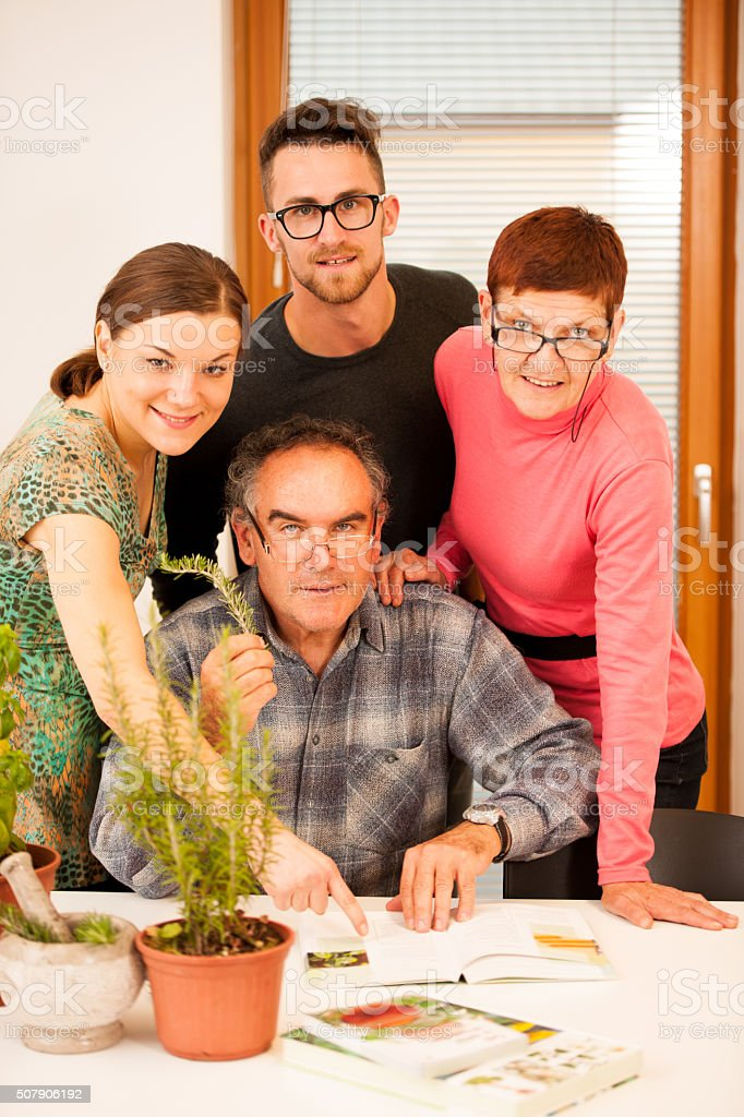 Workshop of knowing herbs, touching and smelling basil and thyme. stock photo