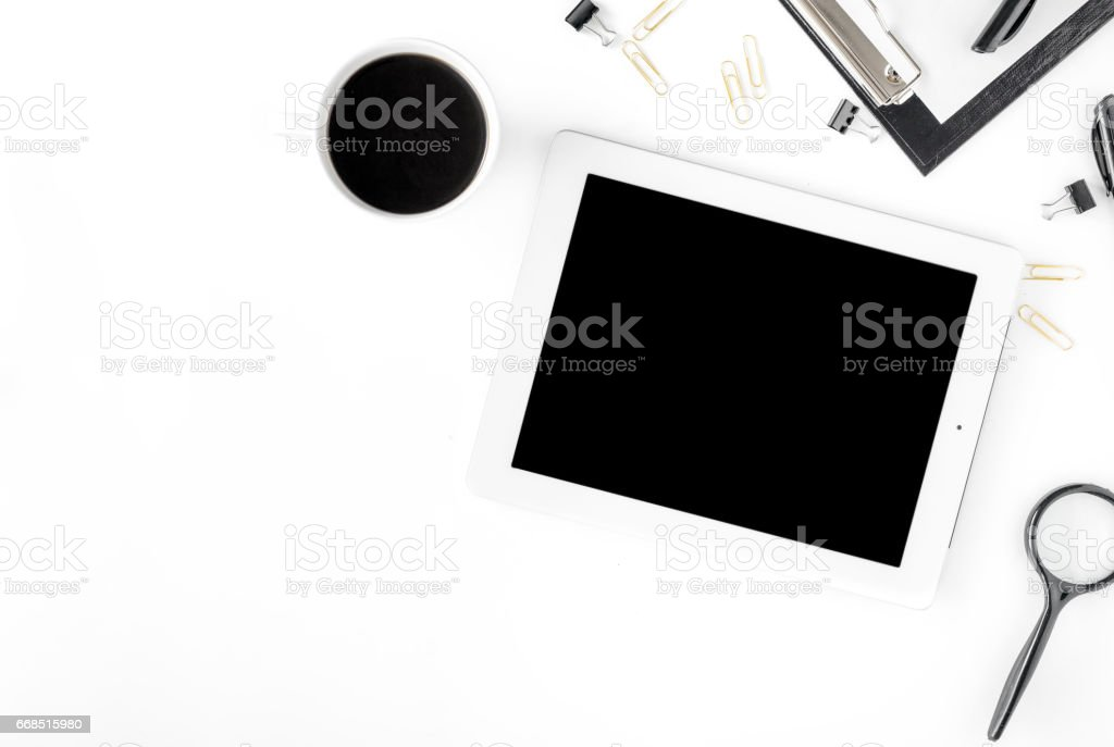 Workspace with tablet, different office accessories and cup of coffee stock photo