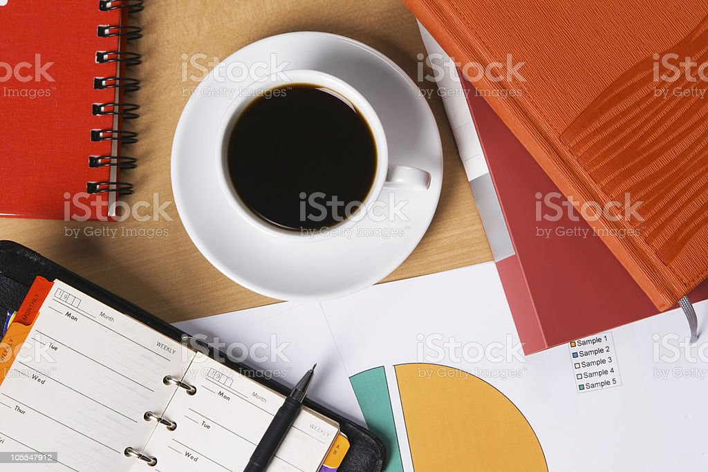 Work-table covered with documents stock photo
