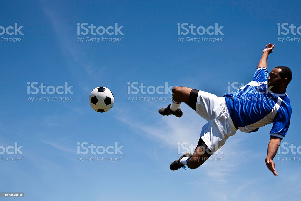 World Cup Soccer Player Kicking the Ball in Air stock photo
