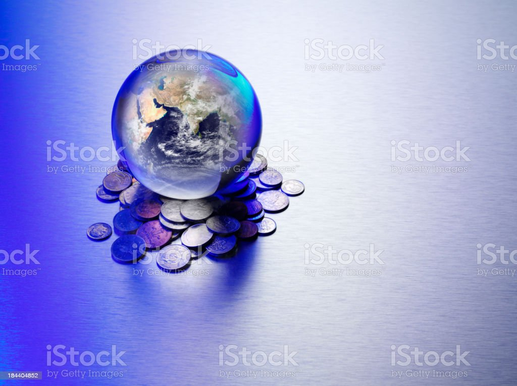 World Currency and asia in a Crystal Ball royalty-free stock photo