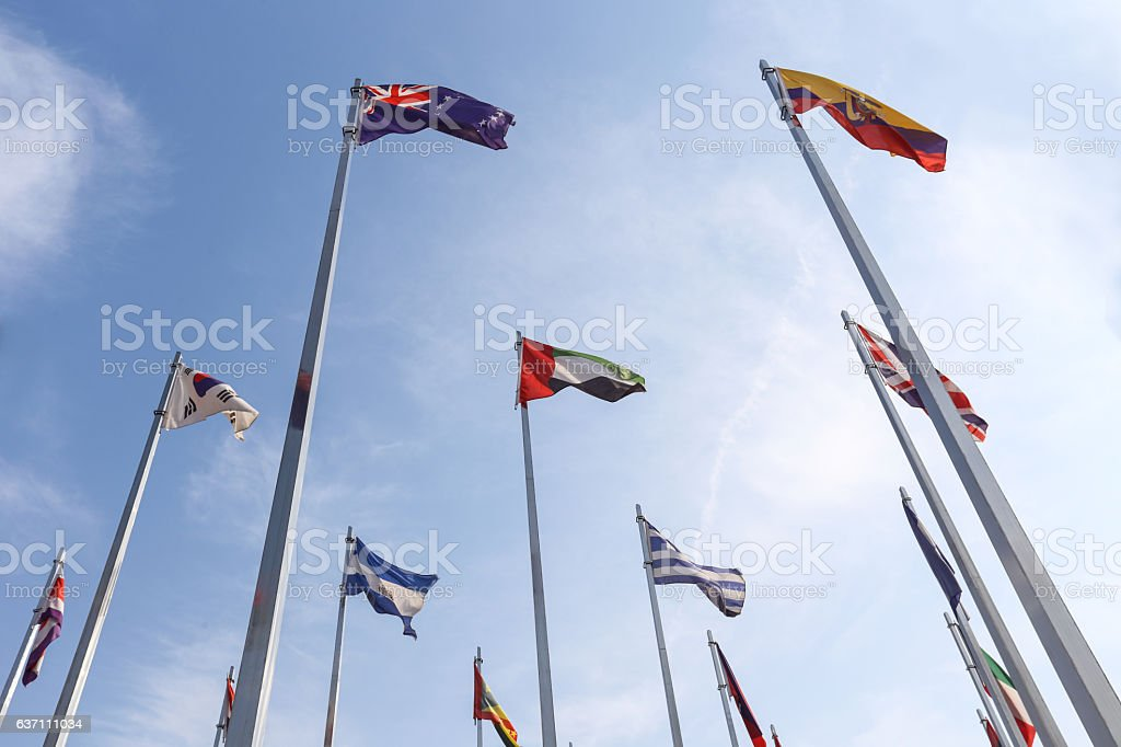 world flag flying in the sky stock photo
