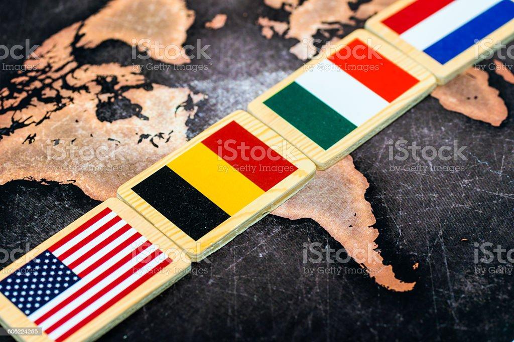 World flags on grunge world map stock photo