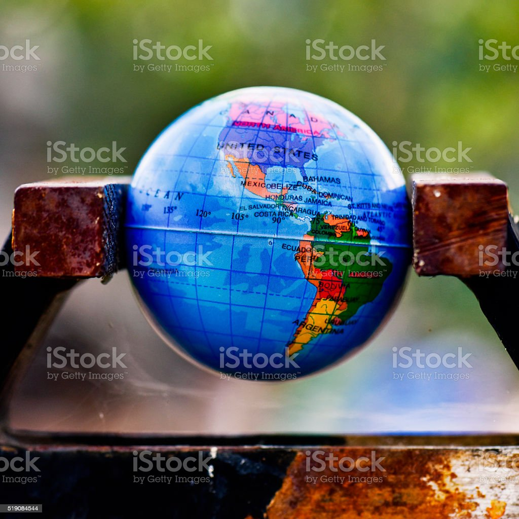 world globe in a vise stock photo