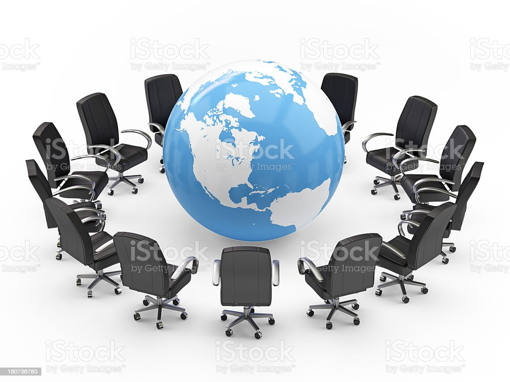 World globe in the middle of a circle of black chairs stock photo