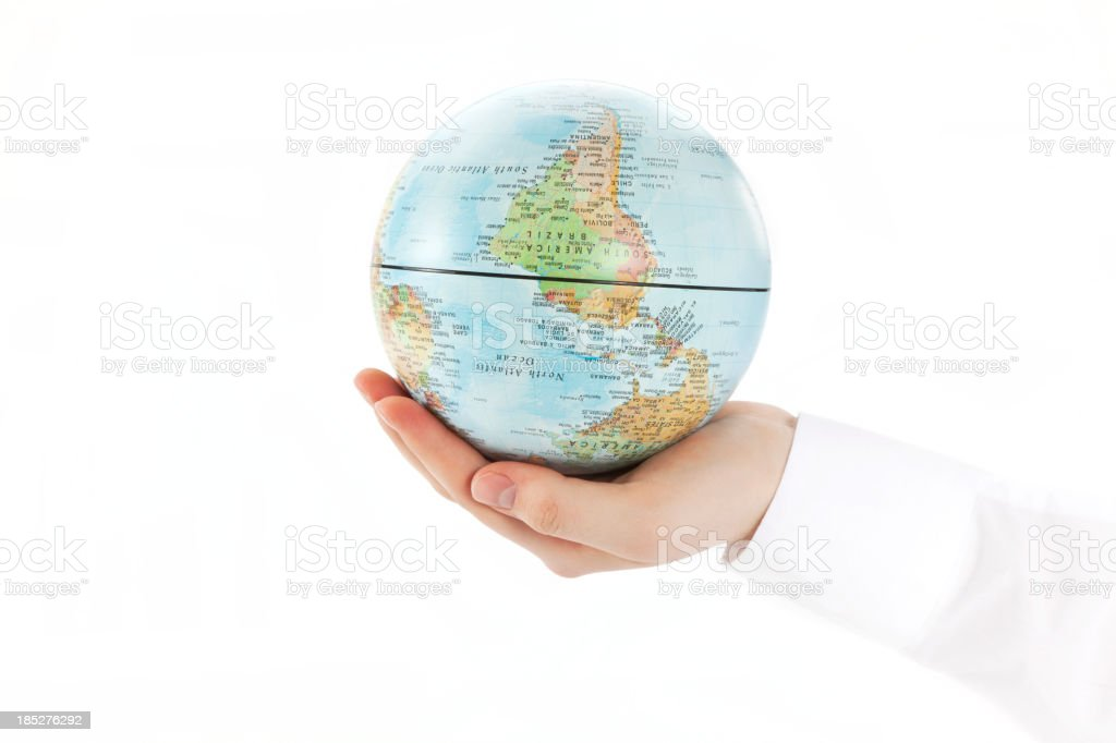 World Globe upside down in palm stock photo