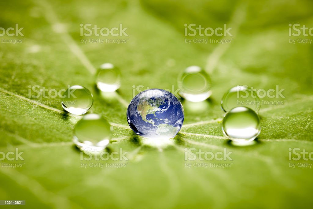 World in a drop macro stock photo
