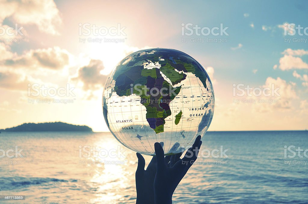world in my hands lifted up against sunset stock photo