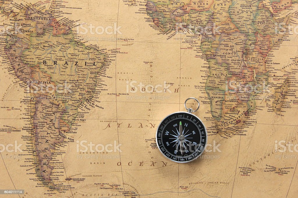 World map and compass stock photo