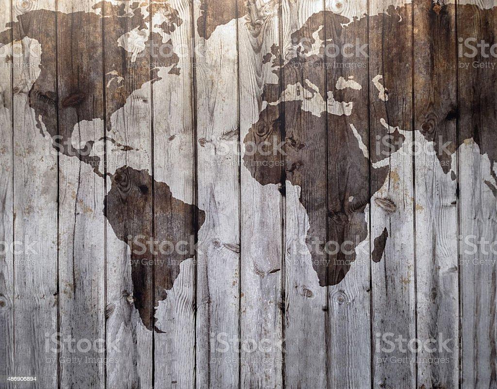 Mapa-múndi de desenho em lona e efeito de madeira foto royalty-free