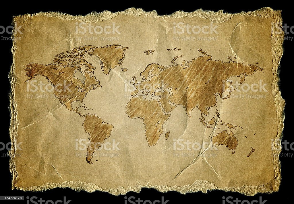 World Map on a old worn paper isolated on black background royalty-free stock photo