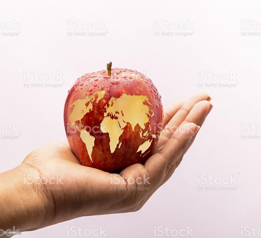 world map on apple stock photo