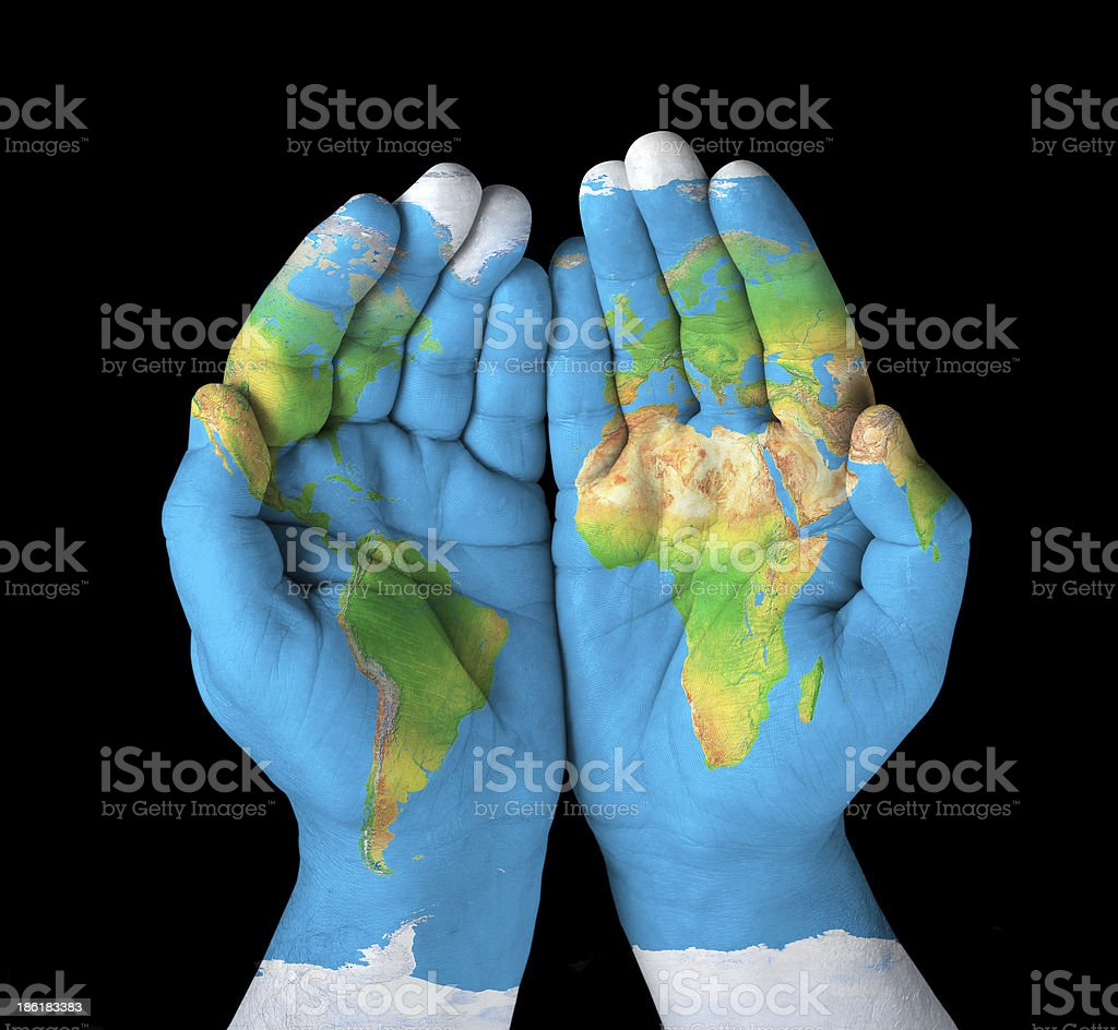 World map painted on hands stock photo