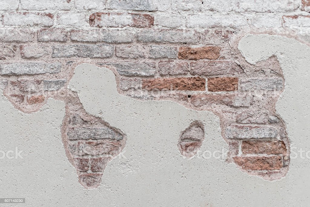 World map, plaster falling from the brick wall stock photo