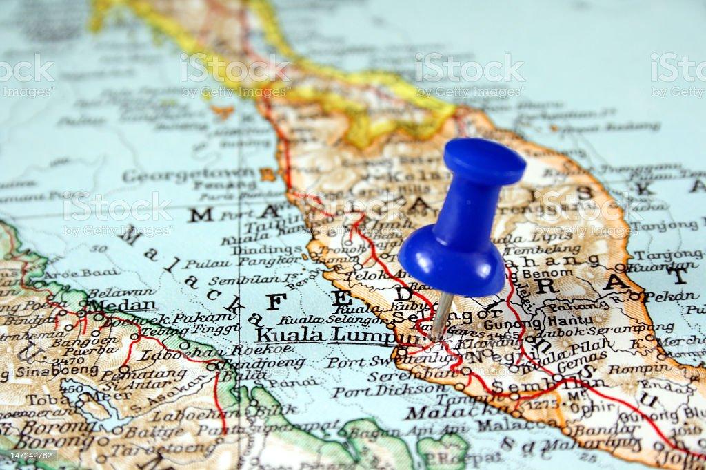 A world map with a thumbtack on Kuala Lumpur, Malaysia stock photo