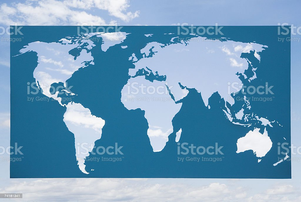 World map with blue sky and clouds royalty-free stock photo