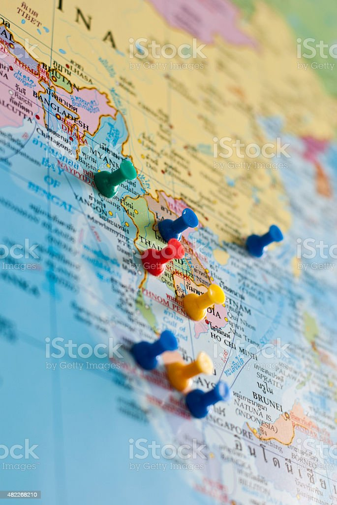 World map with colorful pins stock photo
