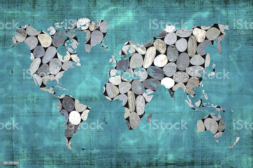 World map zen stones and blue ocean stock photo