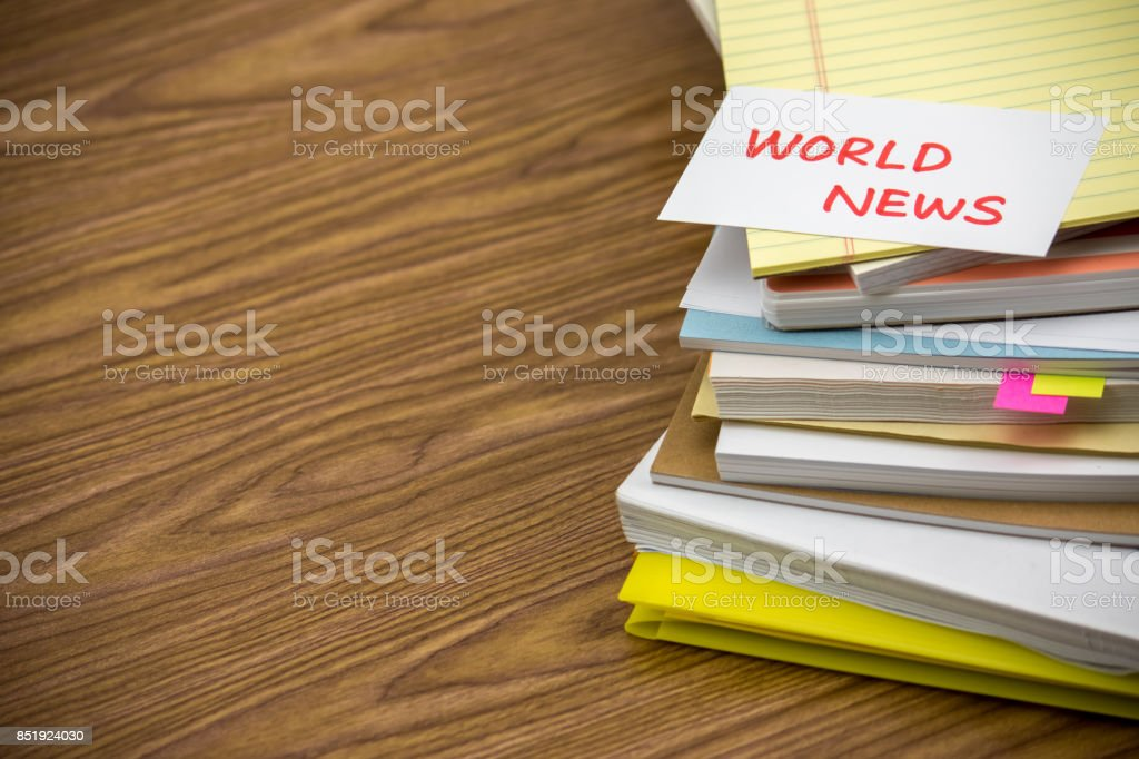 World News; The Pile of Business Documents on the Desk stock photo