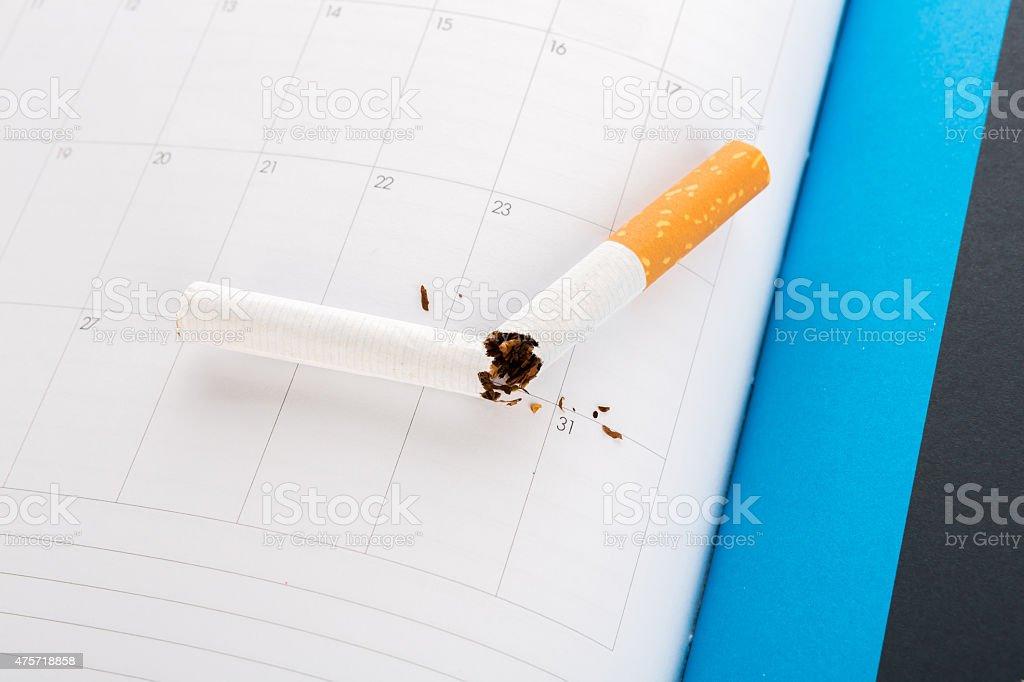 World No Tobacco Day : Broken cigarette  on calendar stock photo