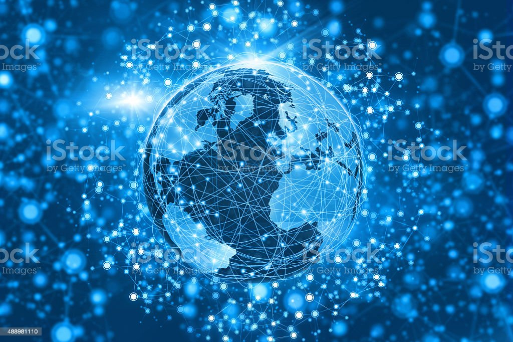 World surrounded by communications network extending into blue space stock photo
