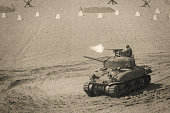 World War 2 Sherman Tank Firing Weapon on Battle Field