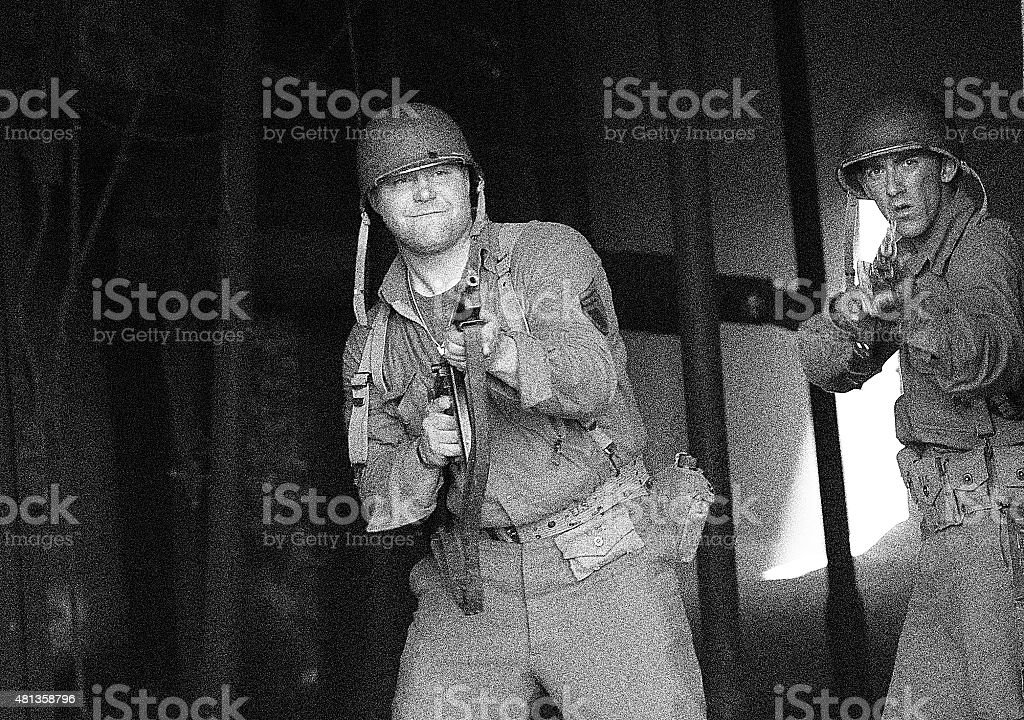 World War 2 Soldiers In Combat Shooting stock photo