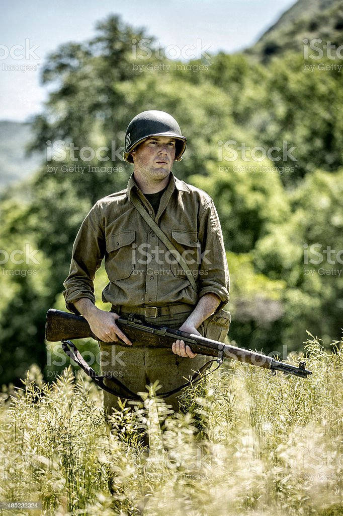 World War II Army Soldier in an Open Field stock photo