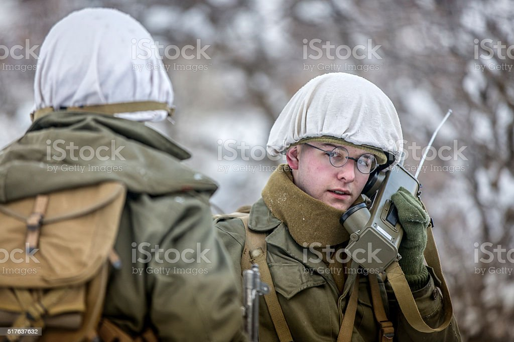 World War II: Soldier with Walkie Talkie in the Snow stock photo