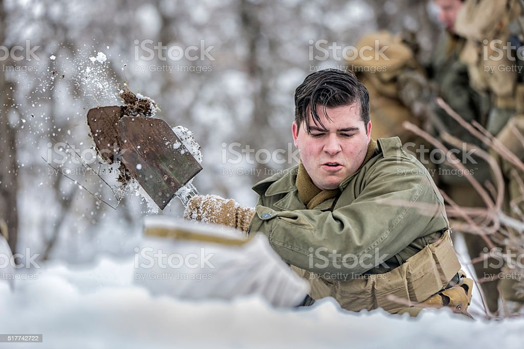 World War II Soldiers Digging Foxholes in the Snow stock photo