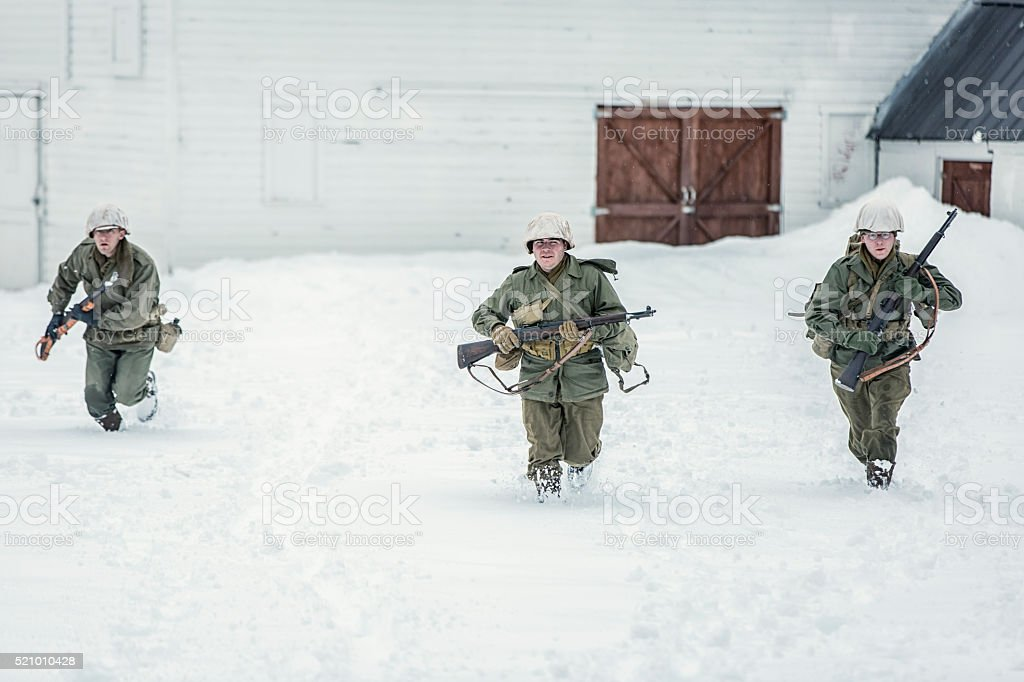 World War II Soldiers in the Snow on Patrol stock photo