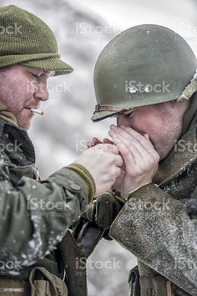 World War II: Two US Army Soldiers Lighting Cigarettes stock photo