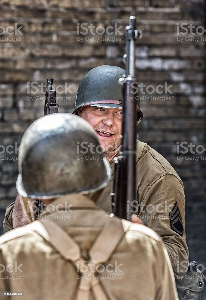 World War II US Army Sergeant Talking To Soldiers stock photo