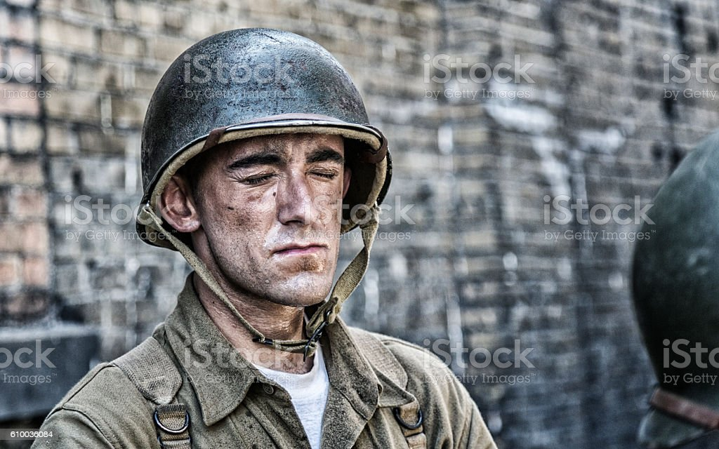 World War II US Army Soldier Eyes Closed Sweating stock photo