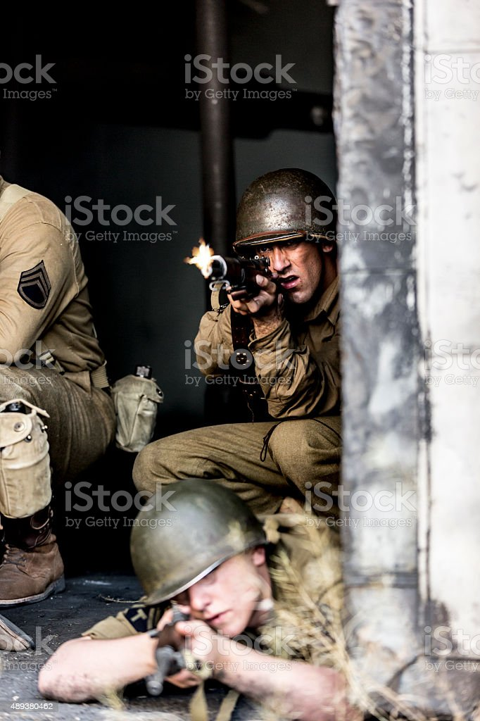 World War II US Army Soldier Firing from Cover stock photo