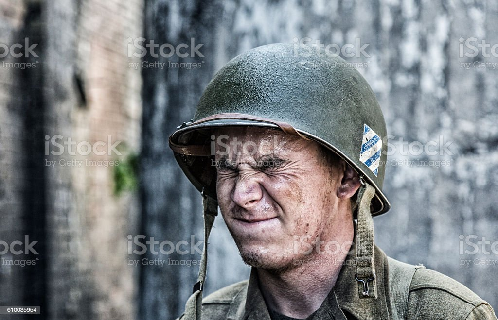 World War II US Army Soldier With Eyes Squeezed Closed stock photo