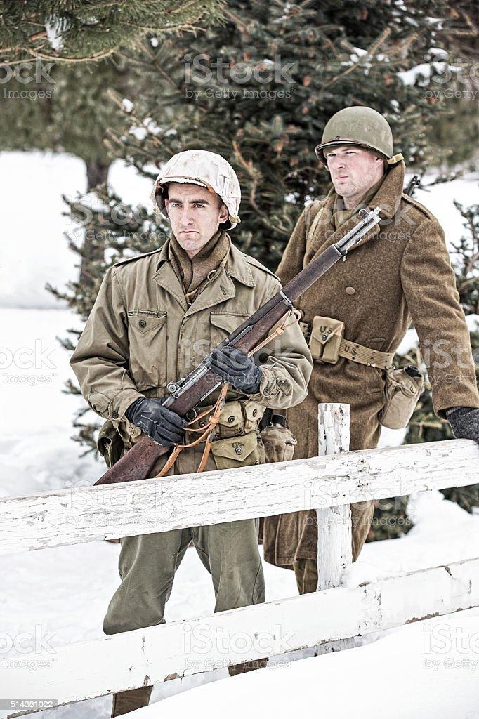 World War II US Infantrymen On Patrol In Snowy Countryside stock photo