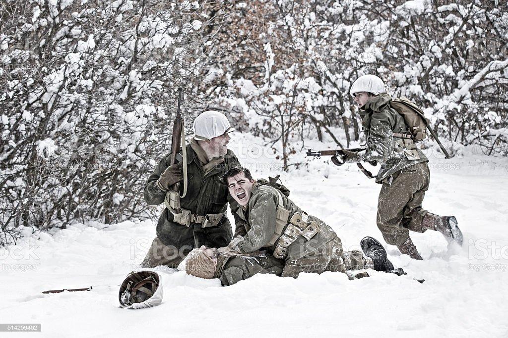 World War II Winter Battlefield Scene With Soldier Down stock photo