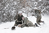 World War II Winter Battlefield Scene With Soldier Down